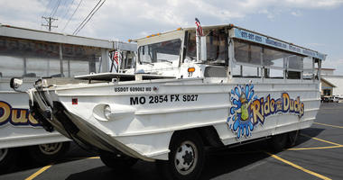 A duck boat sits idle in the parking lot of Ride the Ducks, an amphibious tour operator in Branson, Mo. Friday, July 20, 2018.