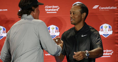 Tiger Woods, right, and Phil Mickelson meet during a news conference where they were announced as captain's picks for the 2018 U.S. Ryder Cup Team