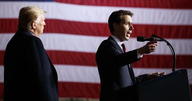 President Donald Trump listens as Republican Senate candidate Josh Hawley speaks during a campaign rally at Columbia Regional Airport, Thursday, Nov. 1, 2018, in Columbia, Mo.