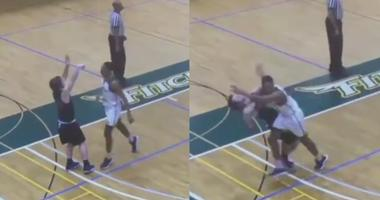 Player throws elbow during Division-III basketball game.