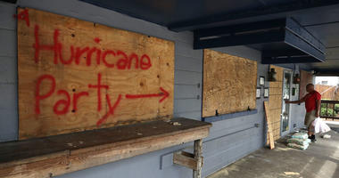 Hurricane Party is written on plywood covering the window of the Lager Heads Tavern as they prepare for the arrival of Hurricane Florence on September 11, 2018 in Wrightsville Beach, United States.