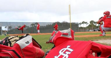 Pitchers throw a bullpen session
