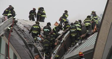 Firefighters fighting fire in roof at St. Louis Lambert International Airport.