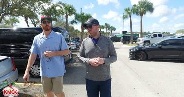 Cardinals pitcher Miles Mikolas walks with KMOX's Chris Hrabe at spring training