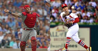 Yadier Molina and Kolten Wong.