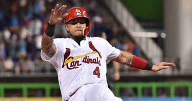 Yadier Molina slides into third base.