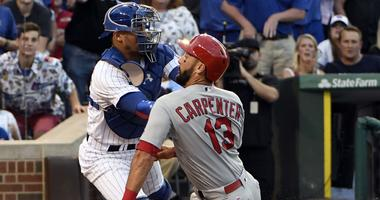 Chicago Cubs catcher Willson Contreras (40) tags out St. Louis Cardinals first baseman Matt Carpenter