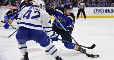 St. Louis Blues center Paul Stastny (26) defends against Toronto Maple Leafs center Tyler Bozak