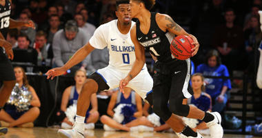 Providence Friars guard Makai Ashton-Langford (1) controls the ball against Saint Louis Billikens guard Jordan Goodwin
