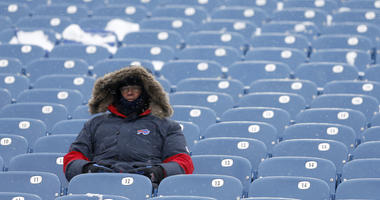 A Buffalo Bills fan sits in the stand before watching a game