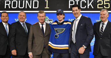 Dominik Bokk poses for a photo with team representatives after being selected as the number twenty-five overall pick to the St. Louis Blues
