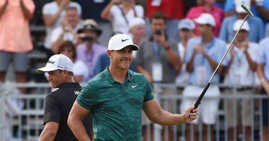 Brooks Koepka celebrates on the 18th green after winning the PGA Championship golf tournament at Bellerive Country Club.
