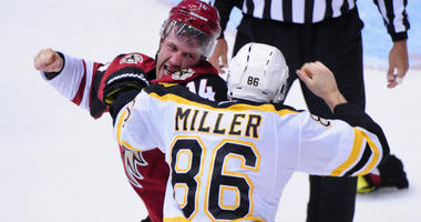 Arizona Coyotes center Joe Vitale (14) and Boston Bruins defenseman Kevan Miller
