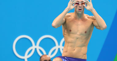 Michael Phelps (USA) during the men's 100m butterfly heats