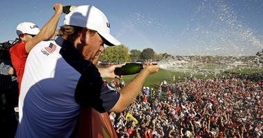 J.B. Holmes of the United States sprays champagne after winning the Ryder Cup during the single matches in 41st Ryder Cup at Hazeltine National Golf Club.