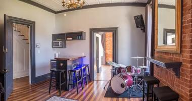 """The practice space and wet bar in """"The Pocket"""""""