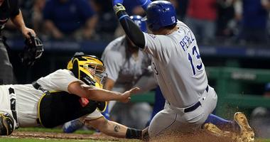 Pirates top Royals in 11 innings