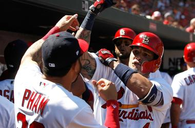 Sep 10, 2017; St. Louis, MO, USA; St. Louis Cardinals catcher Yadier Molina (4) is congratulated by left fielder Tommy Pham (28)