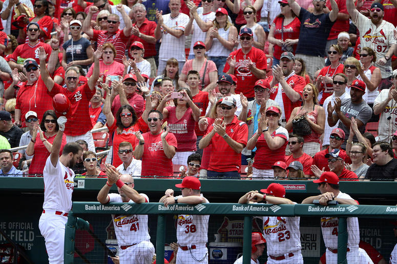 St. Louis Cardinals pitcher Adam Wainwright salutes fans at Busch Stadium
