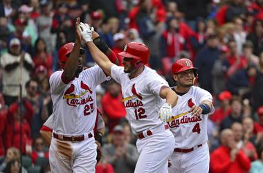 Apr 22, 2018; St. Louis, MO, USA; St. Louis Cardinals shortstop Paul DeJong (12) celebrates with right fielder Dexter Fowler (25) and catcher Yadier Molina (4) after hitting a three run home run.