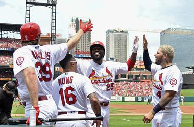 Jul 15, 2018; St. Louis, MO, USA; St. Louis Cardinals right fielder Dexter Fowler (25) is congratulated by starting pitcher Miles Mikolas (39) and second baseman Kolten Wong (16) and catcher Yadier Molina (4) after hitting a solo home run.