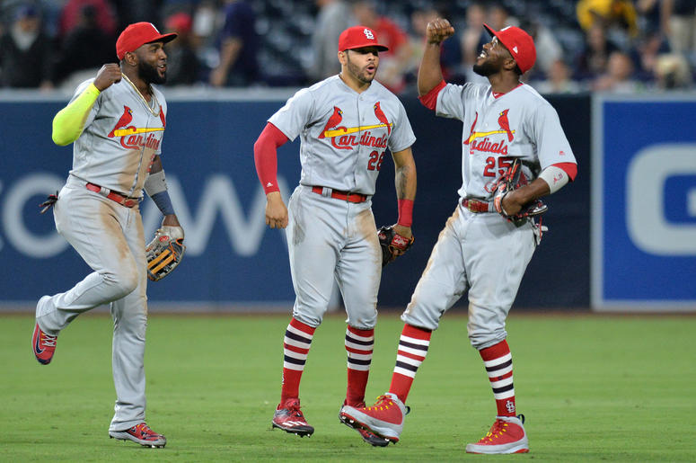 St. Louis Cardinals outfielders Dexter Folwer, Marcell Ozuna and Tommy Pham