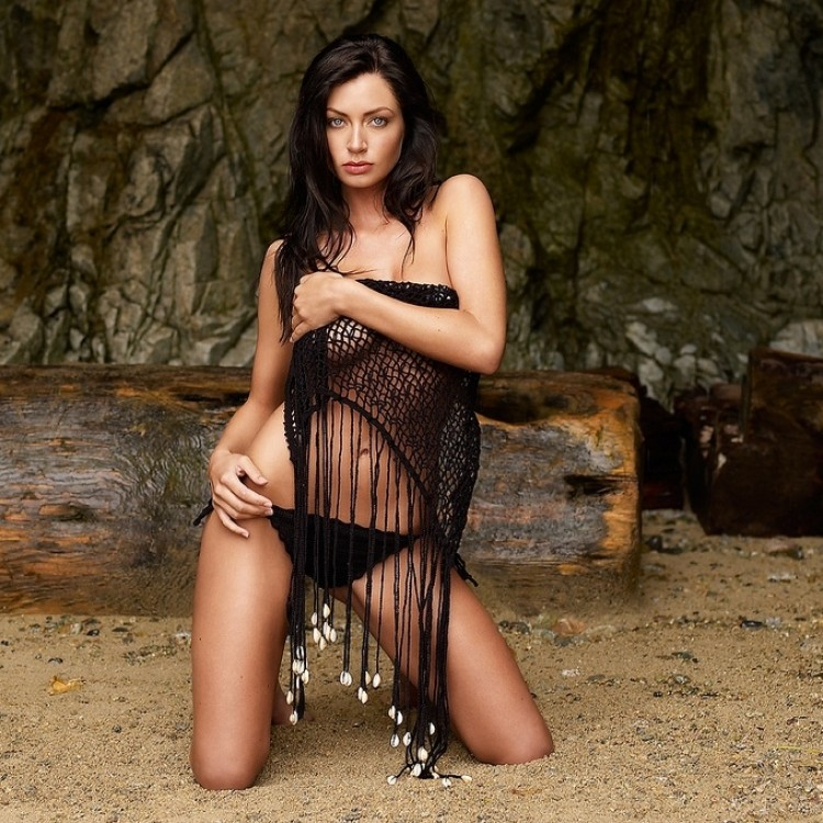 5623-a-beautiful-brunette-in-a-bikini-posing-on-a-beach-pv