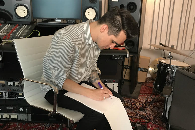 Brendon Urie from Panic! At The Disco drawing a mystery billboard