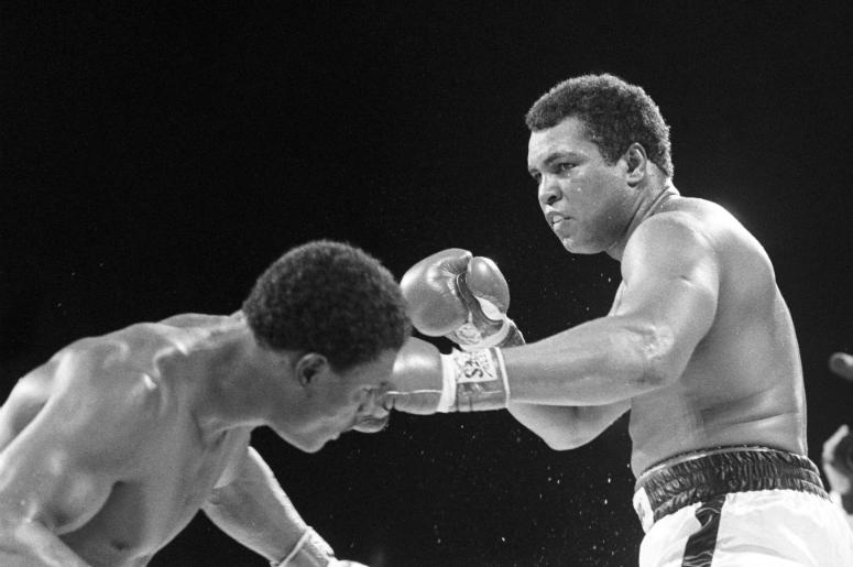 Muhammad Ali fights Trevor Berbick (left) at the Queen Elizabeth Sports Centre. Berwick defeated Ali in ten rounds by unanimous decision and was Ali's last professional fight.
