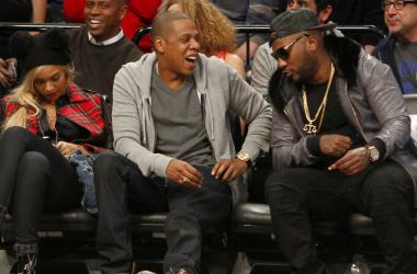 Beyonce, Jay Z and Young Jeezy react during the game between the Philadelphia 76ers and Brooklyn Nets at Barclays Center.
