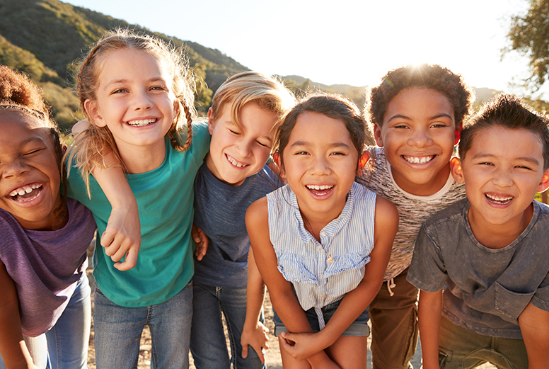 group of smiling children side by side