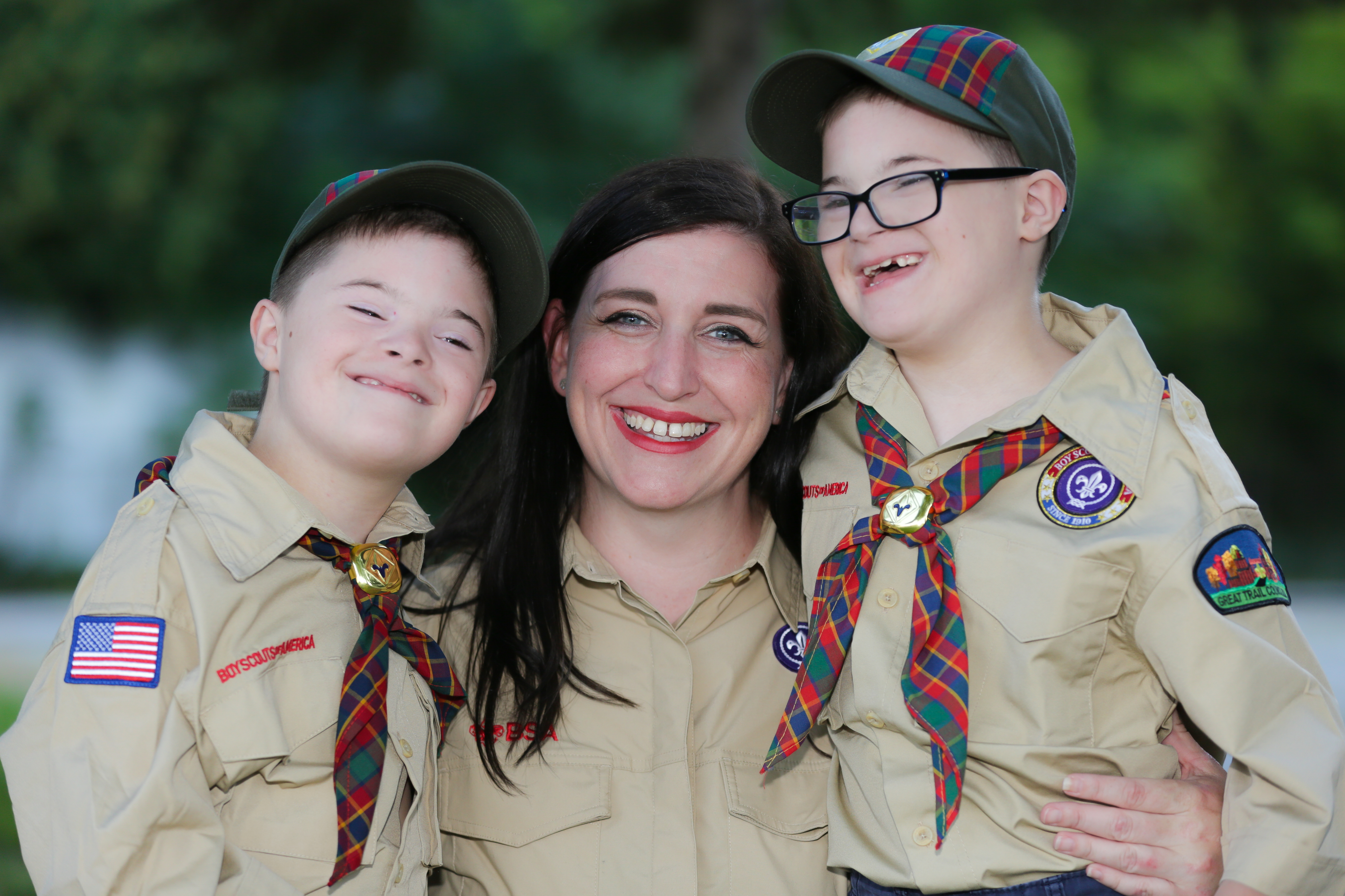 Mom, board president, and advocate Meghan Wilkinson poses with her twin boys, Casey and Connor