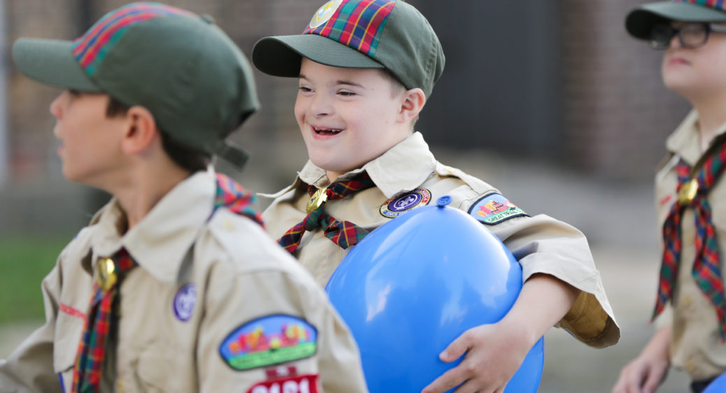 Cub Scouts playing outside