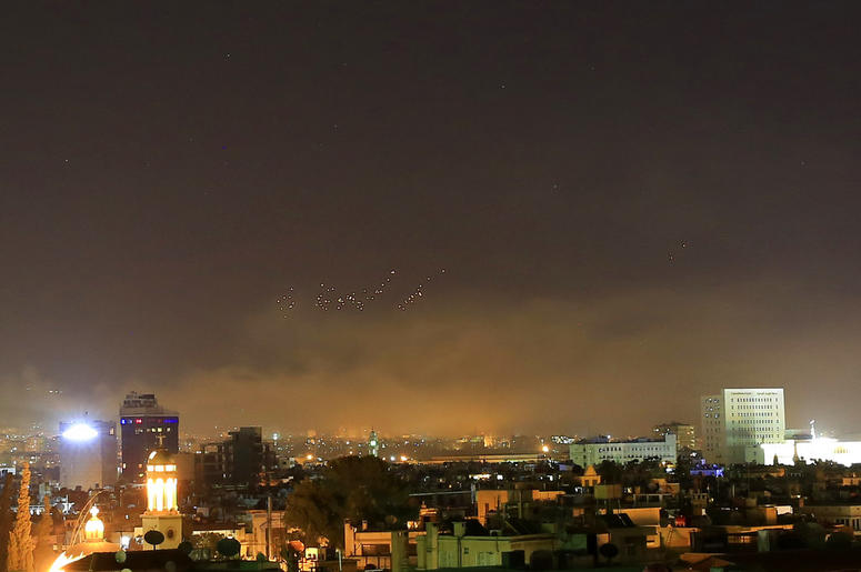 Damascus skies erupt with anti-aircraft fire and smoke as the U.S. launches an attack on Syria targeting different parts of the Syrian capital Damascus, early Saturday, April 14, 2018. Damascus has been rocked by loud explosions.