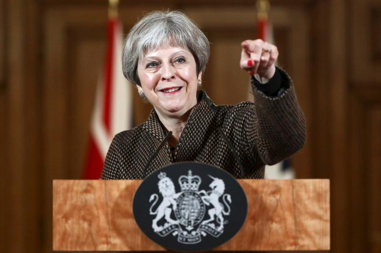 """Britain's Prime Minister Theresa May gestures during a press conference in 10 Downing Street, London, Saturday, April 14, 2018. British Prime Minister Theresa May says the need to act quickly and protect """"operational security"""" led her to strike Syria with"""