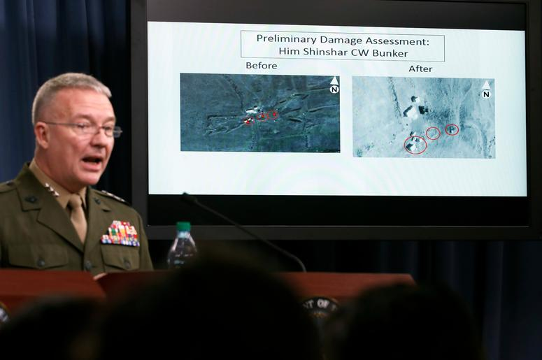 Marine Lt. Gen. Kenneth F. McKenzie Jr., director, Joint Staff, speaks as he shows photographs from before and after the U.S.-led airstrikes against Syria during a media availability at the Pentagon, Saturday, April 14, 2018, in Washington.