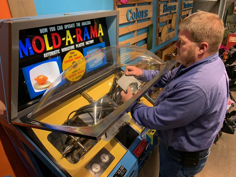 Owner inspecting Mold A Rama machine