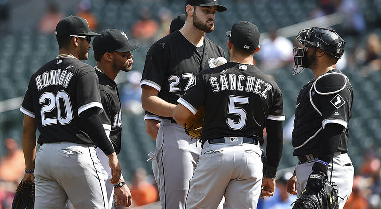 Chicago White Sox starting pitcher Lucas Giolito, center, talks with his infielders after giving up five runs to the Baltimore Orioles in the first inning of a baseball game, Sunday, Sept. 16, 2018, in Baltimore. (AP Photo/Gail Burton)