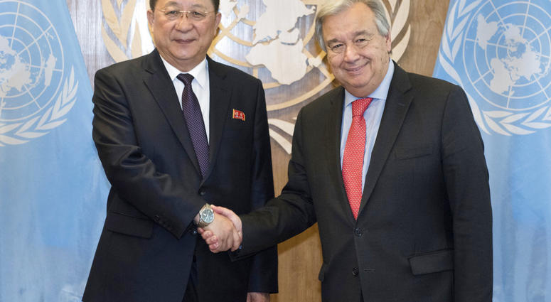 In this photo provided by the United Nations, Ri Yong Ho, left, Minister for Foreign Affairs, Democratic People's Republic of Korea, is greeted by United Nations Secretary General Antonio Guterres.