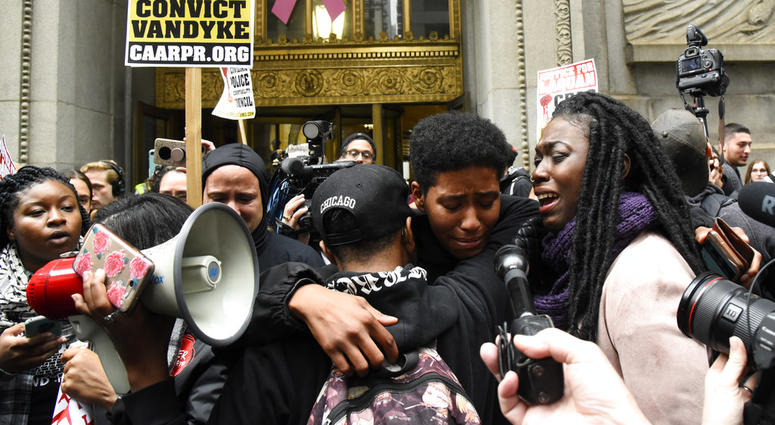 People react outside of City Hall after a jury convicted white Chicago police Officer Jason Van Dyke of second-degree murder in the 2014 shooting of black teenager Laquan McDonald Friday, Oct 5, 2018, in Chicago. Van Dyke, 40, was the first Chicago office