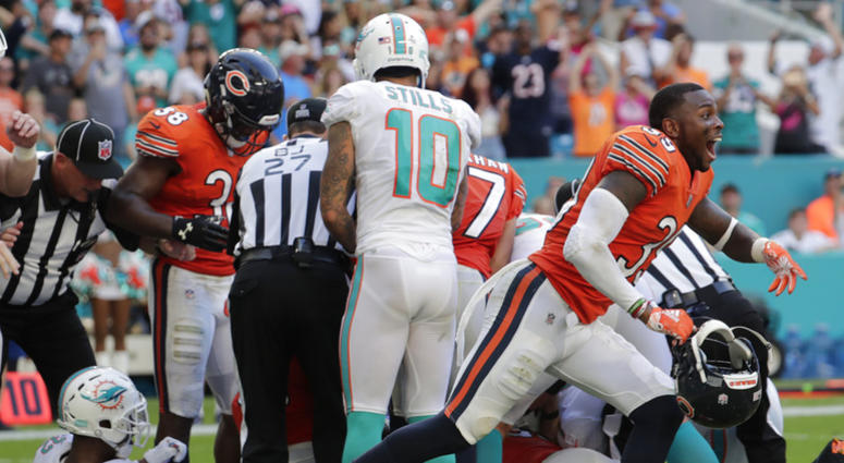 Chicago Bears free safety Eddie Jackson (39) yells to his team after Miami Dolphins running back Kenyan Drake (32) fumbles the ball during overtime at an NFL football game, Sunday, Oct. 14, 2018, in Miami Gardens, Fla. (AP Photo/Lynne Sladky)