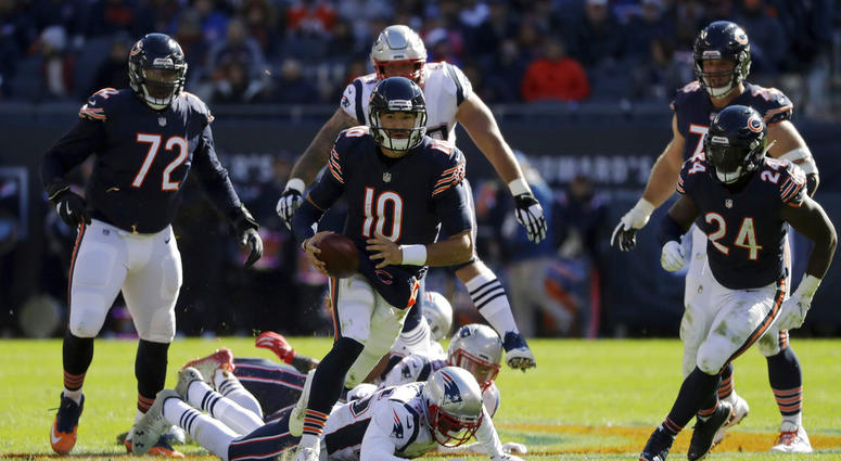 Chicago Bears quarterback Mitchell Trubisky (10) scramble sduring the second half of an NFL football game against the New England Patriots Sunday, Oct. 21, 2018, in Chicago. (AP Photo/Nam Y. Huh)