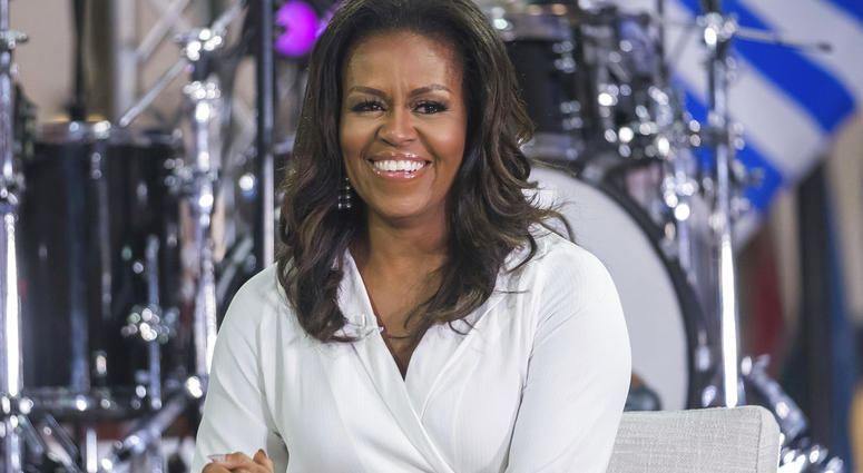"""In this Oct. 11, 2018 file photo, Michelle Obama participates in the International Day of the Girl on NBC's """"Today"""" show in New York. Oprah Winfrey and Reese Witherspoon will be among the special guests when Michelle Obama goes on tour for her memoir """"Be"""
