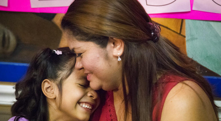 Allison, 6, and her mother Cindy Madrid share a moment during a news conference, Friday, July 13, 2018, in Houston. The press conference, the mother and daughter spoke about the month and one day they were separated under the President Donald Trump admin.