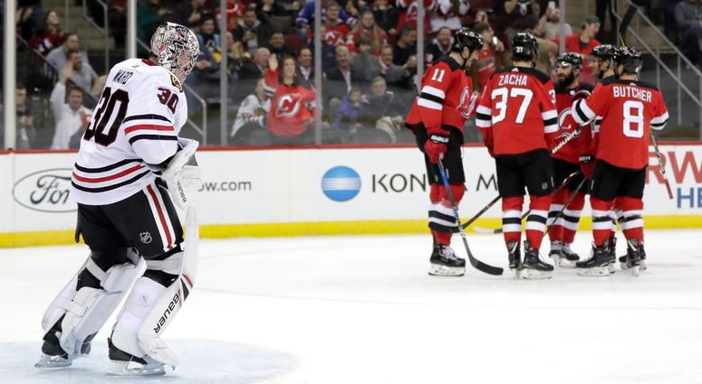 Devils Surge Past Blackhawks, 8-5