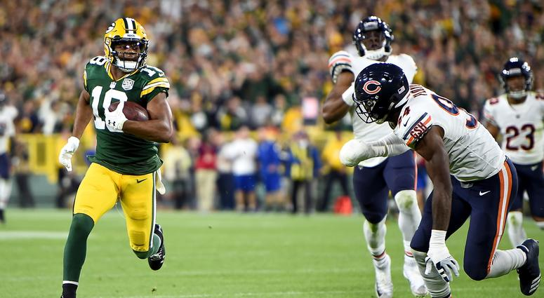 Packers receiver Randall Cobb scores the winning touchdown against the Bears.