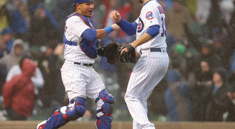 Apr 14, 2018; Chicago, IL, USA; Chicago Cubs relief pitcher Brandon Morrow (15) and catcher Willson Contreras (40) celebrate after the final out of the ninth inning against the Atlanta Braves at Wrigley Field. Chicago won 14-10.