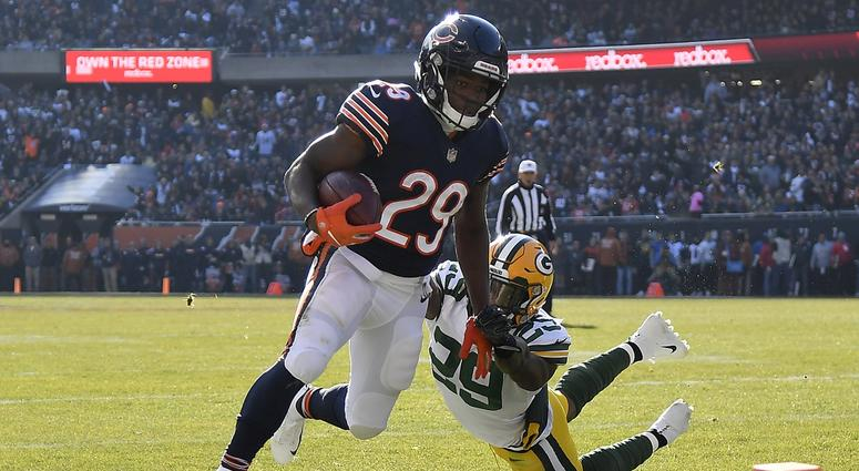 Dec 16, 2018; Chicago, IL, USA; Chicago Bears running back Tarik Cohen (29) breaks the tackle of Green Bay Packers strong safety Kentrell Brice (29) to score a touchdown at Soldier Field. Mandatory Credit: Quinn Harris-USA TODAY Sports