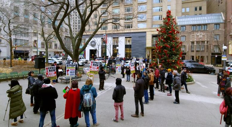 Protesters rally for police accountability on Michigan Avenue on Black Friday.