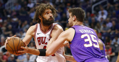 Chicago Bulls center Robin Lopez looks to shoot over Phoenix Suns forward Dragan Bender (35) during the second half of an NBA basketball game, Monday, March 18, 2019, in Phoenix.